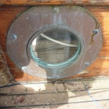 The Portholes were fitted before the coaming.