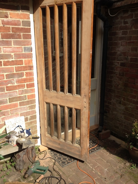 The front door after stripping and sanding