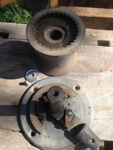 An old tufnol and bronze winch, dismantled ready for cleaning.