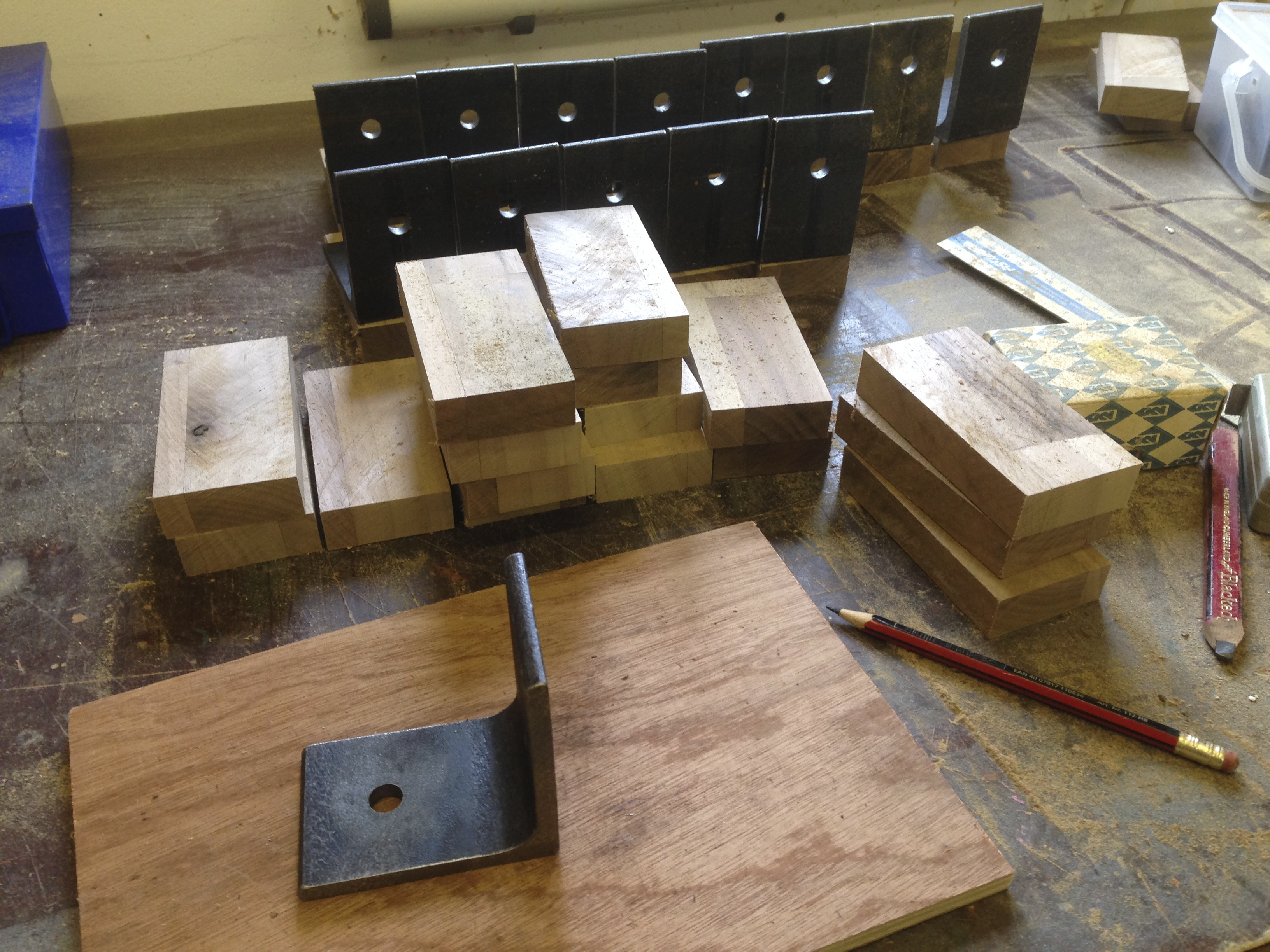 Leftover Walnut worktop cut into blocks and marked up ready for drilling