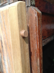 Screw holes filled with teak grain plugs