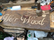 Carving the Weir Wood sign